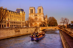 Tourist boat approaching Notre-Dame cathedral Stock Photography