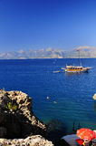 Tourist boat in beautiful sea. Beautiful blue sea boat with mountains in background Royalty Free Stock Image