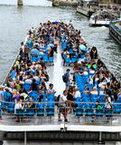 Tourist boat with blue chairs on the river Seine in Paris, France Royalty Free Stock Images
