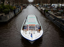 Tourist boat on the channel of Amsterdam, the Netherlands Stock Photos