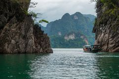 Tourist boat on Cheow Lan Lake stock photo