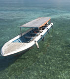 Tourist Boat on clear crystal ocean. Fills with sea-weeds and plankton Royalty Free Stock Photo
