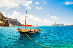 Tourist boat and cruise ship in the sea Royalty Free Stock Images