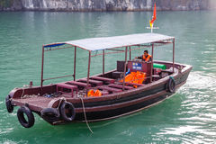 A tourist boat cruising on the waters of Ha Long Bay in Vietnam Stock Image