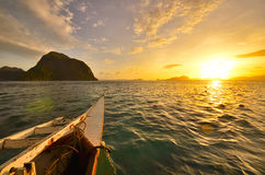 Tourist boat destinations on the island of El Nido at sunset. Ph. Destinations boat on background amazing beautiful sunset. travel summer to islands coral reef royalty free stock photo