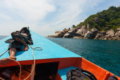 A tourist boat driver is napping on his boat in the sea of Phangan, Thailand. Dream job Stock Photography