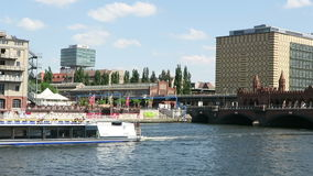 Tourist boat driving on Spree River at Oberbraumbruecke in Berlin. BERLIN, BERLIN/ GERMANY MAY 09 2016: Tourist boat driving on Spree River at Oberbraumbruecke stock video footage