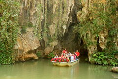 Tourist boat exiting cave in Cuba Stock Photos