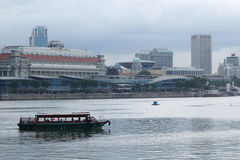 Tourist boat floating on Singapore river Stock Photography