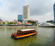 Tourist boat floating on Singapore river Stock Image
