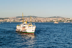 Tourist boat floats along the Bosphorus Royalty Free Stock Photos