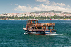 Tourist boat floats along the Bosphorus in Istanbul Stock Photos