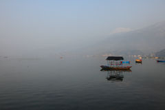 A tourist boat floats on the Fewa lake Royalty Free Stock Photos
