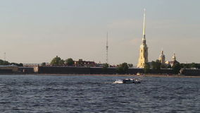 Tourist boat floats in front of Peter and Paul Fortress stock video footage