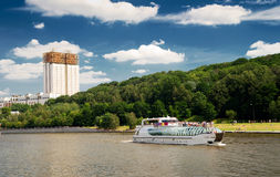 Tourist boat floats on the Moskva River in Moscow Royalty Free Stock Photography