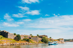 Tourist Boat Floats Near The Sea Fortress Of Suomenlinna. Histor Royalty Free Stock Images