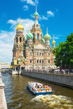 Tourist boat floats past the Church in St Petersburg Royalty Free Stock Photos