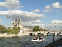 Tourist boat  floats past the Louvre Royalty Free Stock Images