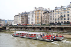 Tourist boat floats on the Seine river Royalty Free Stock Images