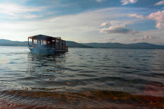 Tourist boat floats on water. Tourist boat floats on the water in the summer Stock Photography