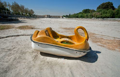 Tourist boat in the form of a swan thrown into the dried river royalty free stock photo