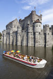 Tourist boat full of colorful people on river near Gravenstein C Royalty Free Stock Photography