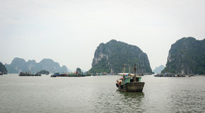 A tourist boat at Halong Bay in Quang Ninh, Vietnam.  Stock Photo