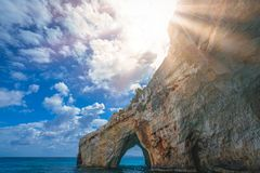 Stone arch entrance to Blue Caves in Zante. Stone arch entrance to one of the many Blue Caves in Zante Island, Greece royalty free stock images