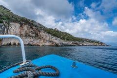 Tourist boat heading for Blue Caves in Zante. Front of a blue tourist boat heading for the Blue Caves, Zante Island, Greece stock image