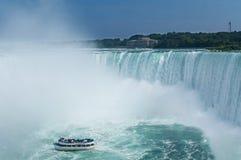 Tourist boat heading towards Niagara Falls Royalty Free Stock Photos