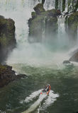 Tourist boat at Iguasu Falls. MW - A tourist boats heads into the spray ao the  Iguasu Falls is on the Argentinian side Stock Photography