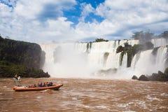 Tourist boat at Iguazu falls. Cascades at Argentina Stock Photo