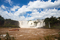 Tourist boat at Iguazu falls. Cascades at Argentina Royalty Free Stock Images