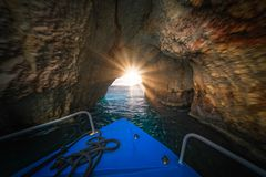 Tourist boat inside Blue Caves in Zante. Front of a blue tourist boat sailing inside the Blue Caves, Zante Island, Greece stock images