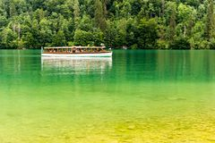 Tourist boat on Konigsee lake in Berchtesgaden National Park. Tourist boat on Konigsee lake in Berchtesgaden National Park in summer, Germany royalty free stock photography