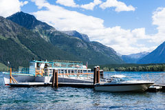 Tourist boat on Lake McDonald in West Glacier waiting for visitors to board Stock Photos