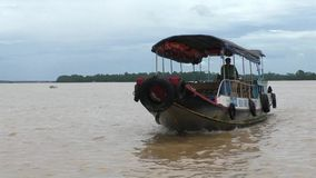 Tourist boat on Mekong River in Vietnam. Tourist boat on Mekong River, Delta of Mekong River in Vietnam stock footage