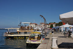 Tourist boat moored in harbor in Porec, Croatia on summer day Stock Image