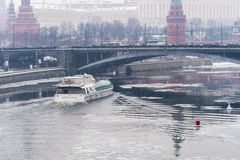 Tourist boat, Moscow Kremlin, snow Royalty Free Stock Images