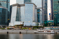 Tourist boat on Moskva river near skyscrapers Stock Images