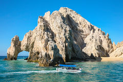 Tourist boat near The Atch in Cabo San Lucas. CABO SAN LUCAS, MEXICO -MARCH 20, 2012 :  Boat with tourists approaching The Arch  Cabo San Lucas, Mexico Royalty Free Stock Photos