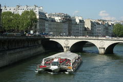 Tourist boat in Paris Royalty Free Stock Images