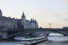 Tourist boat in paris Stock Images