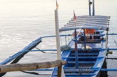 Tourist Boat Parked at Lake-shore that cater to inter island travelers. Batangas, Philippines – December 25, 2015: Tourist Boat Parked at Lake-shore that royalty free stock photography