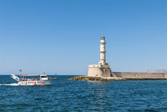 Tourist boat passes lighthouse Chania Stock Image