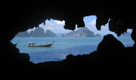 Tourist boat on Phang Nga Bay, Thailand. Seen from inside a cave Royalty Free Stock Photo