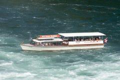 Tourist boat at Rhine Falls, Switzerland Stock Images