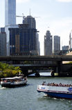 Tourist boat rides on the chicago river Royalty Free Stock Photo