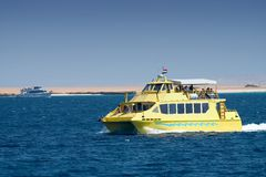 Tourist boat on river in Egypt. Scenic view of tourist boat on river with desert landscape on shoreline, Egypt Royalty Free Stock Photography