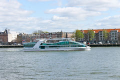 Tourist boat on the river Maas in Rotterdam. Royalty Free Stock Images